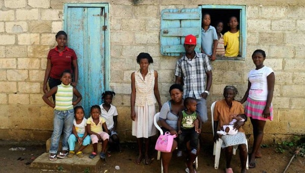 Sentilia Igsema, born in 1930 in the Dominican Republic to Haitian immigrants, with four generations of her family outside their home in the eastern Seibo province.